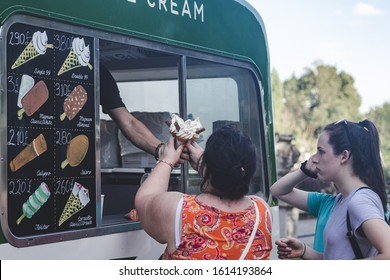 London/UK- 22/07/19: a woman bought the 99 Flake ice-cream in Ice-cream van. A 99 Flake ice-cream usually made with soft serve ice-cream, into which a Flake bar has been inserted
