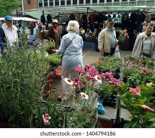 LONDON/UK- 22nd may 2019: People shopping at flower stall, in Romford market in London's east end.