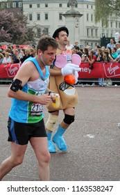 London/UK 4/17/11 Virgin London Marathon 2011 by Buckingham Palace.  Mr Potato Head nears the finish line