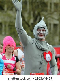 London/UK 4/22/12 Virgin London Marathon 2012. Passing by Buckingham palace a male runner in a Tin Man costume approaches the nearby finish line