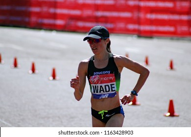 London/UK 4/22/18 Virgin Money London Marathon 2018 Rebecca Wade of USA passes Buckingham Palace about 300 yards from the finish line. She finished 11th in the womens elite race
