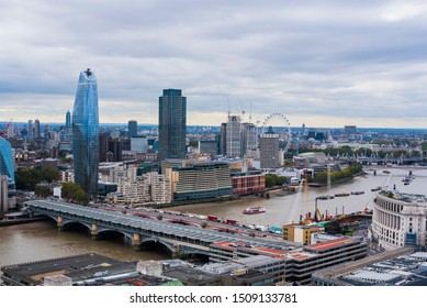 London/UK -  9/29/2018: View of London skyline from top of St. Pauls Cathedral, london bridge with traffic, river thames on a cloudy day