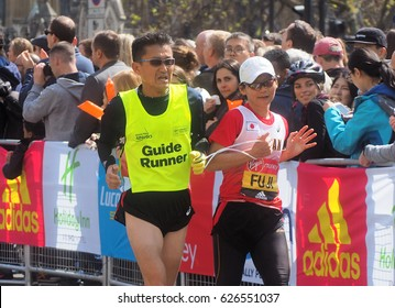 London.UK. April 23rd 2017.The London Marathon passes Westminster and the Houses of Parliament
