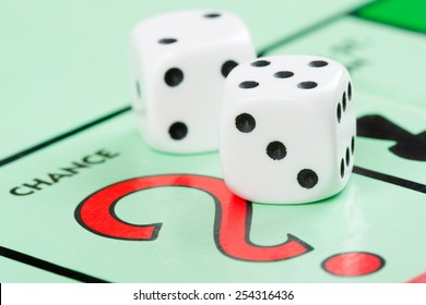 LONDON,UK - FEBRUARY 11, 2015 : Pair of dice next to the CHANCE card drawing space in a Monopoly game board