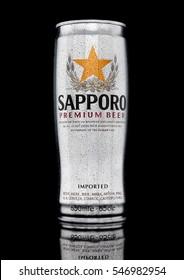 LONDON,UK - JANUARY 02, 2017: A can of Sapporo Beer with frost on black background. The Japanese brewery was founded in 1876 by German trained brewer Seibei Nakagawa.