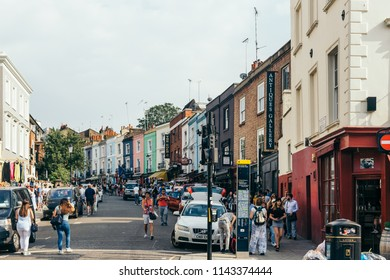 London/UK - July 21 2018: People walking on Portobello Market, one of London's notable street markets, known for its second-hand clothes and antiques
