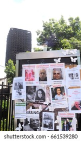 London.UK. June 17, 2017.Posters of the missing in the Grenfell Tower disaster are posted in the shadow of the  burned out shell of Grenfell Tower
