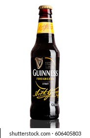 LONDON,UK - MARCH 21, 2017 : Bottle of Guinness foreign extra beer on white background.Guinness beer has been produced since 1759 in Dublin, Ireland.