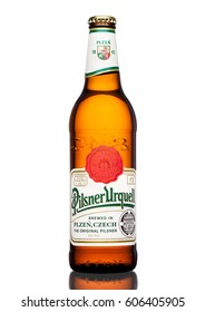 LONDON,UK - MARCH 21, 2017 :  Bottle of Pilsner Urquell beer on white background.It has been produced since 1842 in Pilsen, Czech Republic.