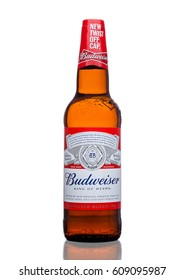 LONDON,UK - MARCH 21, 2017 : Bottle of Budweiser Beer with new twist off cap on white background. An American lager first introduced in 1876.