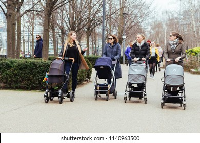 London/UK - March 25 2018: four mothers walking with the strollers along the Southbank, London