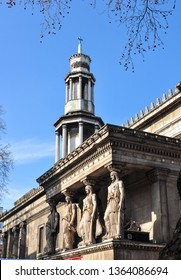 LONDON/UK - March 26, 2019. Four Caryatids and the Tower on St Pancras New Church (from Duke's Road), Bloomsbury, London, England