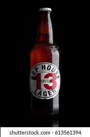 LONDON,UK - MARCH 30, 2017 :  Bottle of Hop House 13 lager beer on black background.