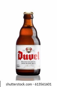 LONDON,UK - MARCH 30, 2017 :  Bottle of Duvel Beer on white background. Duvel is a strong golden ale produced by a Flemish family-controlled brewery, exported to more than 40 countries.