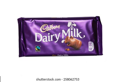 London,UK - March 4th 2015: A bar of Britains favourite chocolate - Cadbury's Dairy Milk - isolated on a white background