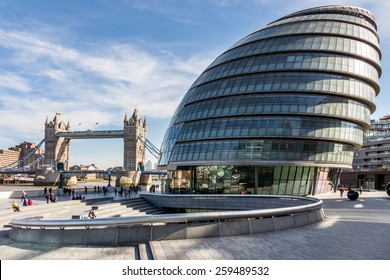 LONDON/UK - MARCH 7 : View of City Hall and Tower Bridge in London on March 7, 2015. Unidentified people.