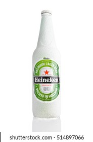 LONDON,UK -NOVEMBER 11, 2016: Bottle of Heineken Lager Beer covered with snow. Heineken is the flagship product of Heineken International
