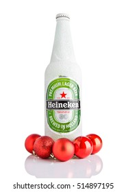 LONDON,UK -NOVEMBER 11, 2016: Bottle of Heineken Lager Beer covered with snow and red christmas balls. Heineken is the flagship product of Heineken International