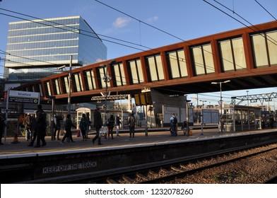 London/UK- November 11 2018: Iron bridge walkway above platforms at Stratford showing Westfield shopping development. Credit Katherine Da Silva