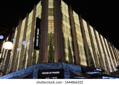 London/UK - November 28, 2013: Garlands of thousands of LED lights decorate the House of Fraser superstore during Christmas night hours.