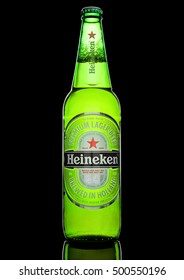 LONDON,UK -OCTOBER 17, 2016: Bottle of Heineken Lager Beer on black background. Heineken is the flagship product of Heineken International