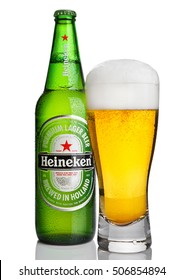 LONDON,UK -OCTOBER 23, 2016: Bottle of Heineken Lager Beer with glass on white background. Heineken is the flagship product of Heineken International