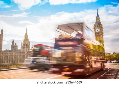 London,UK. Red bus in motion and Big Ben, the Palace of Westminster. HDR