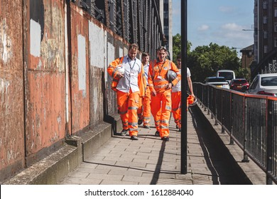 London/UK-22/07/19: Crossrail construction workers walking along the street. Crossrail Limited is the company that has been set up to build the new railway that will become known as the Elizabeth line