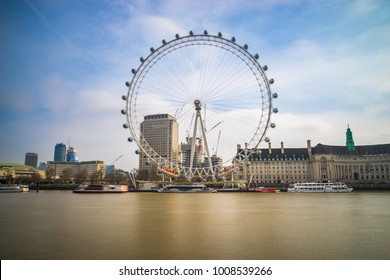 LONDON,UK-3.01.2018:South Bank of the River Thames at in the morning with The London Eye in motion