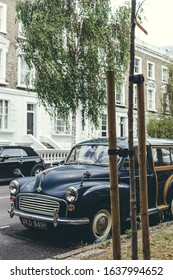 London/UK-30/7/18: dark blue Morris Oxford Series MO Traveller 1953 by Morris Motors is a two-door estate version of the Series MO with an exposed wooden frame at the rear, parked on a London street