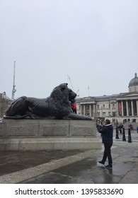London,UK-April 7,2019:Tourists visit Trafalgar Square in London,UK. Trafalgar Square is famous place in London.