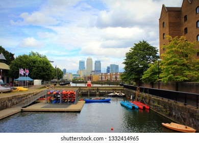 London,UK-August 13th 2016:Canary Wharf tall buildings seen from Shadwell Basin.The basin was part of the London Docks at Wapping,now used for recreational purposes-sailing, canoeing and fishing