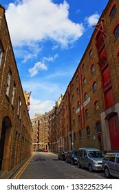 London,UK-August 13th,2016:A view of Wapping High Street lined with many old warehouses converted into luxury flats in the London Borough of Tower Hamlets on a bright summer day