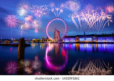 London,UK-December 2018:Fireworks near The Millennium wheel known as London Eye. It's a cantilevered observation wheel on the South Bank of the River Thames