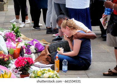 London.UK.June 17th 2017.Locals visit the memorial wall for  the victims of the Grenfell Tower disaster