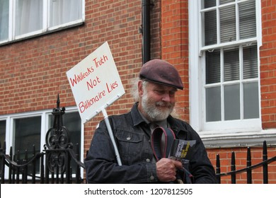 London/UK-June 19 2018: Supporter of Julian Assange Vigil Event, holds a placard 'Wikileaks Truth Not Billionaire Lies!' Outside the Embassy where Julian Assange has been held in detention for 6 years