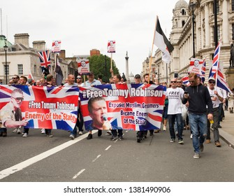 """London"""".UK/June 9 2018: Free Tommy Robinson Protest. Tommy Robinson Supporters marching down Whitehall, Westminster. London"""