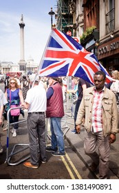 """London"""".UK/June 9 2018: Tommy Robinson Protest. Tommy Robinson supporters, waving flags in Whitehall, Westminster. London"""