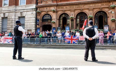"""London"""".UK/June 9 2018: Tommy Robinson Protest. Metropolitan Police Officers watching over Tommy Robinson Supporters outside """" The Lord Moon of the Mall"""" Public House in Whitehall, Westminster. London"""