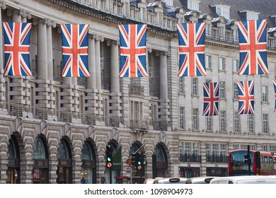 London/United Kingdom - 05 20 2018: English flags and taxis on Oxford Street