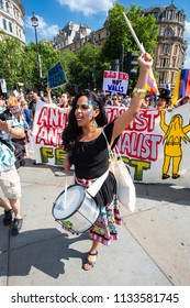 London/United Kingdom - July 13, 2018: Protests against Donald Trump continue with a march in central London ending up in Trafalgar Square for a rally. Marching to the beat of a drum.