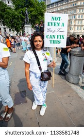London/United Kingdom - July 13, 2018: Protests against Donald Trump continue with a march in central London ending up in Trafalgar Square for a rally. A gin and tonic can fix most things.