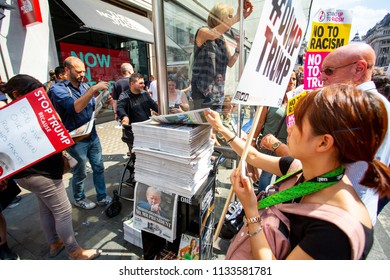 London/United Kingdom - July 13, 2018: Protests against Donald Trump continue with a march in central London ending up in Trafalgar Square for a rally. London's newspapers were flying off the shelves.