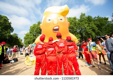 London/United Kingdom - July 13, 2018: Donald Trump's visit to England is met with protests and a blimp flying over London. The protest team poses for the cameras with Angry Trump Baby.