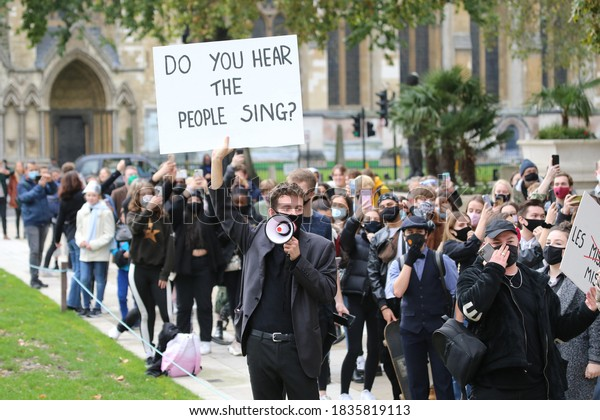 London/United Kingdom - October 18 2020: Young singers effected by the shutdown of the entertainment industry because of Covid-19 restrictions stage a protest outside British parliament.