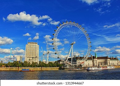 London,United Kingdom-August 13th 2016:Scenic view of Thames River and South Bank with London Eye in nice summer day seen from Victoria Embankment near Hungerford Bridge and Golden Jubilee Bridges