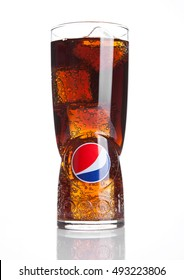 LONDON,UNITED KINGDOM-OCTOBER 03, 2016: Original large glass with pepsi cola and ice cubes with reflection. Pepsi is a carbonated soft drink that is produced and manufactured by PepsiCo. Created 1893.
