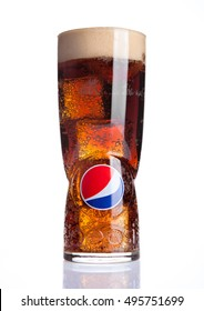 LONDON,UNITED KINGDOM-OCTOBER 03, 2016: Original large glass with pepsi cola and ice cubes with reflection. Pepsi is a carbonated drink that is produced and manufactured by PepsiCo. Created  in 1893.