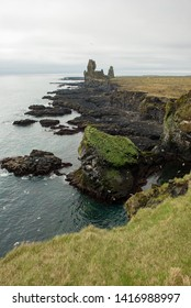 Londrangar Basalt Cliffs in Iceland, Snaefellsnes Peninsula on the Atlantic coast. Black volcanic landscape with rock pinnacles