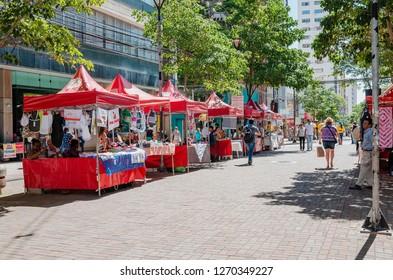 Londrina - PR, Brazil - December 12, 2018: Craftwork being sold on red tents on downtown (calçadão de Londrina).